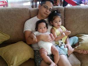 Daddy and his two angels. Hmmm, lacking one more perhaps?